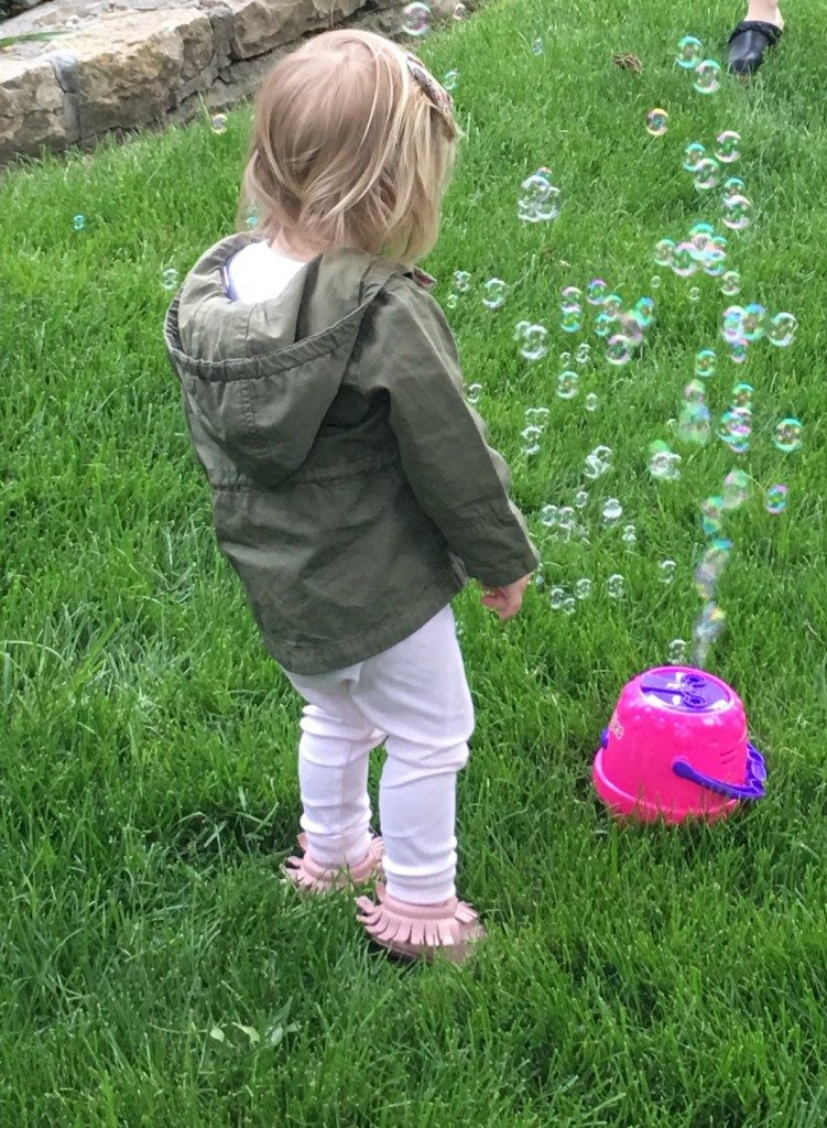 Collins playing with bubbles