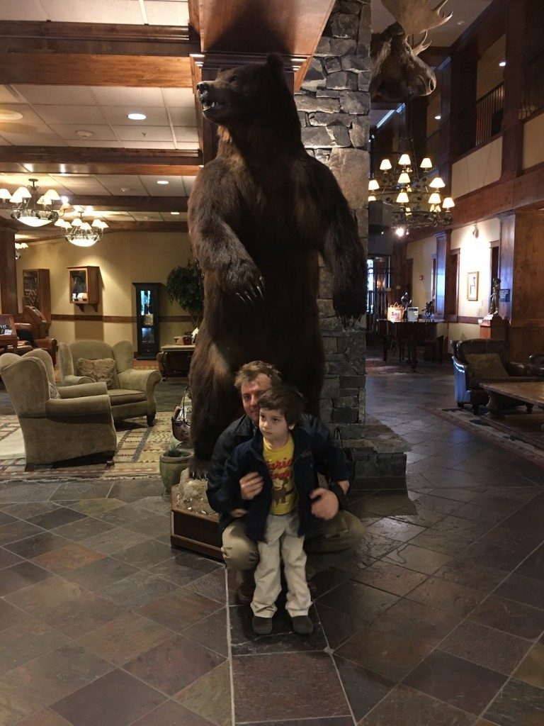 B.J. and Jack in front of Bear lobby at The Lodge at Whitefish Lake