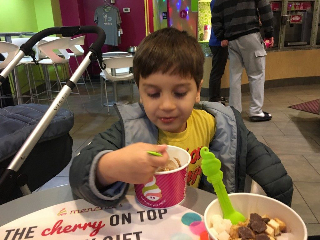 Jack eating his yogurt at Menchie's